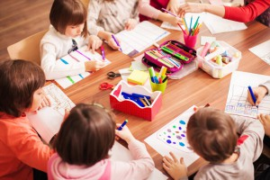 Children in elementary school working  and learning on the works